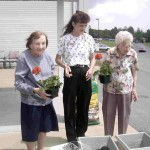 Esther creates planters for the ladies at DuBois Village