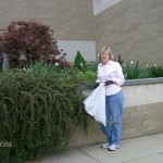 Ellen in front of the main bed at the City Building. The plant is a cotoneaster.